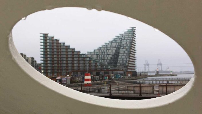 The courtscraper AARHus through a hole in Salling Tower.